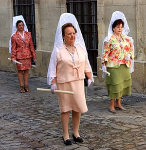 Your Pictures: Three women on an Easter Sunday procession, Jerez, Spain