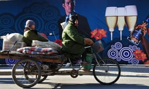 Migrants on a flatbed tricycle