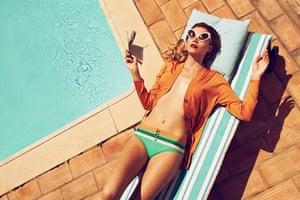 Swimming Pool Fashion: Model wearing tan coloured cardigan and green bikini bottoms