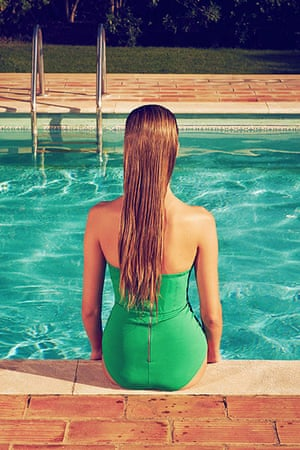 Swimming Pool Fashion: Model wearing green swimming costume