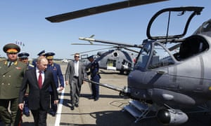 Vladimir Putin inspects Mi-24 helicopters