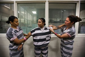 All-female chain gang: Inmates roll up their sleeves before a day's work
