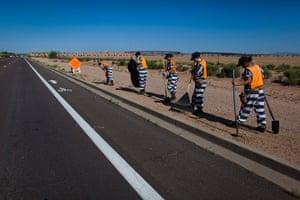 All-female chain gang: Female chain gang pull weeds on a highway roadside