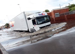 UK Flooding: Jarrow, Tyne and Wear: A lorry drives through floodwater