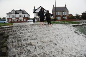 UK Flooding: Whitley Bay, North Tyneside: Water gushes down a set of steps