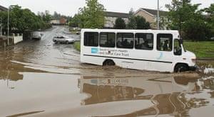 UK Flooding: Lisburn Northern, Ireland: A bus driver drives through flood water