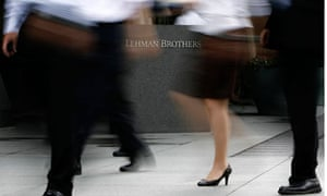 People walk past a Lehman Brothers sign in Tokyo