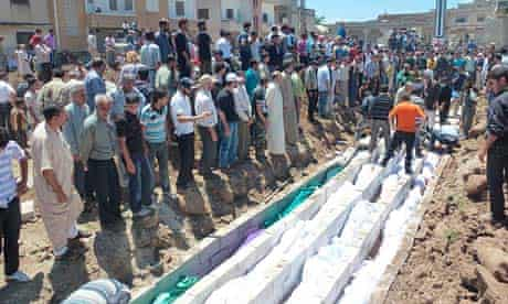 Mass burial for victims of Houla massacre