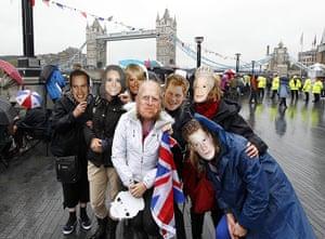Jubilee pageant update: Members of the public wear royal masks near Tower Bridge