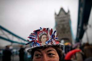 Jubilee pageant update: Royal supporter waits in the rain on Tower Bridge