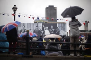 Jubilee pageant update: Revellers Blackfriars Bridge infront of a Royal family banner