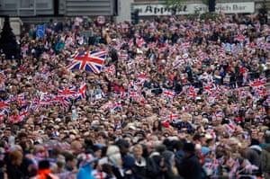 Regatta: Thousands of revellers line the embankment near Blackfriars Bridge