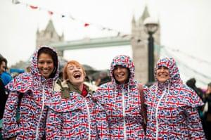 Regatta: Spectators await the start of the river pageant near Tower Bridge
