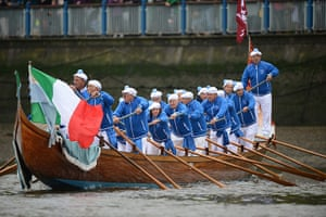 Jubilee boat pageant: Participants from Venice row a boat flying the Italian flag