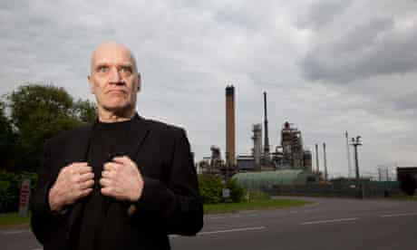 Wilko Johnson  lead guitarist with Dr Feelgood outside Coryton Oil Refinery, Essex
