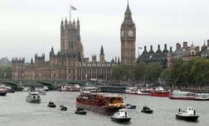 Jubilee Thames pageant: The Royal barge passes crowds lining the river near Houses of Parliament