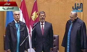 Mohamed Morsi (centre) is sworn in as Egyptian president at the constitutional court in Cairo