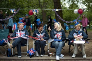 Diamond Jubilee day 2: Royal supporters sit on chairs with Union Jack decorations on the Mall