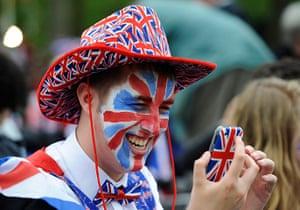 Diamond Jubilee day 2: A Union Jack-themed man checks his mobile phone