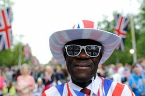 Diamond Jubilee day 2: A man wears a Union Flag outfit as he waits on The Mall