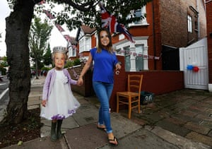 Diamond Jubilee day 2: A mother and daughter wear masks in Ealing, west London
