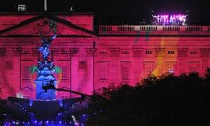 Buckingham Palace is illuminated as Brit