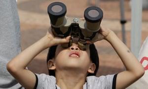 Korean boy watches transit of Venus