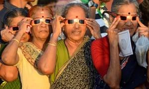 Indian women watch the transit