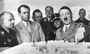 Albert Speer and Adolf Hitler inspect a model of a new building