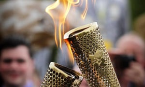 Olympic torch being lit from another torch