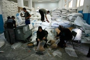 Gaza life: Workers prepare sacks of flour