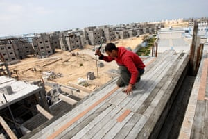 Gaza life: A labourer works at a construction site