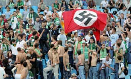 Ukrainian football fans with Nazi flag