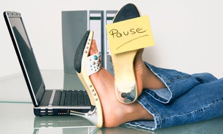 Woman at work with feet up on desk