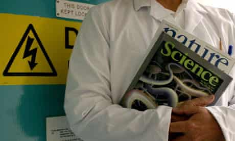 A scientist carrying the journals Science and Nature
