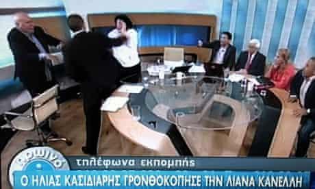 Ilias Kasidiaris strikes Liana Kanelli, a Greek Communist MP