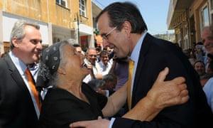 Antonis Samaras greets a supporter