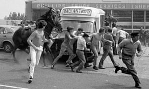 Miners being chased by mounted police at Orgreave