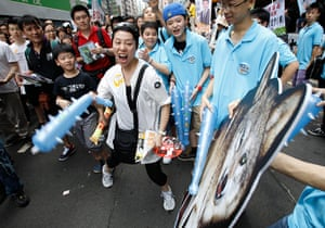 Hong Kong demonstrations: A protester hits a cut-out of a wolf, which represents Leung Chun-ying