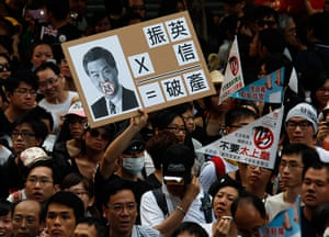 Hong Kong demonstrations: A protester holds a sign mocking new leader Leung Chun-ying