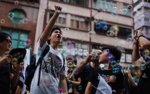 Hong Kong demonstrations: A pro-democracy demonstrator yells slogans as he marches in Hong Kong
