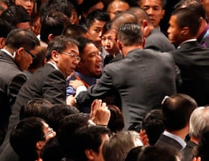 Hong Kong demonstrations: A protester is restrained as he chants slogans at president Hu Jintao