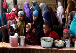 Somalia Goran Tomasevic: Children wait in line during a food distribution from an NGO in Mogadishu