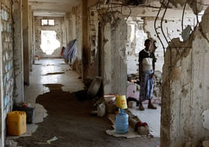 Somalia Goran Tomasevic: A man stands in a destroyed building in Mogadishu