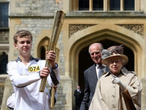 The Queen and Prince Philip watch as the Olympic flame visits Windsor Castle on 10 July 2012.