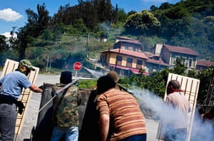 Longer view miners: Miners fire handmade rockets during clashes with Spanish riot police