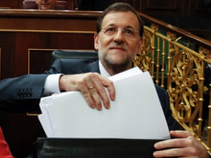 Spain's Prime Minister Mariano Rajoy takes documents from his briefcase in parliament in Madrid, July 2012.