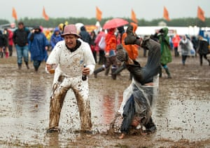 Wet festivals: Festival goers brave the weather at day two of T In The Park Festival