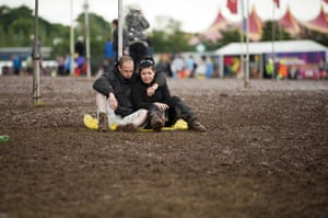 Wet festivals: Music fans sit in the mud and the rain during T In The Park Festival