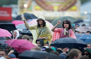 Wet festivals: Festival goers amongst the crowd enjoy the performance at Wireless